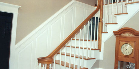 Wainstotting on stairways and walls provides an intriguing accent to your home