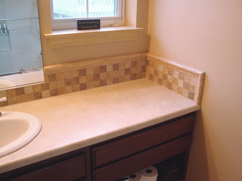 Tile accent in the back splash above sink and vanity area.