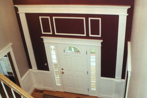 A Wainscot and chair rail on the wall, together with wood molding accents provide an entry highlight